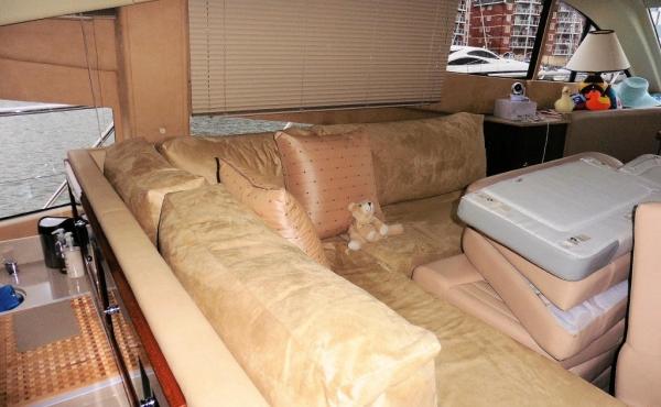 L shaped cream leather sofa on board