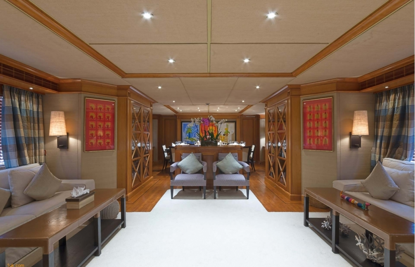 Luxury saloon area with cream carpets and wooden interior
