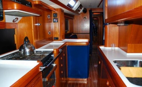 Wooden interior with white work top in the Galley