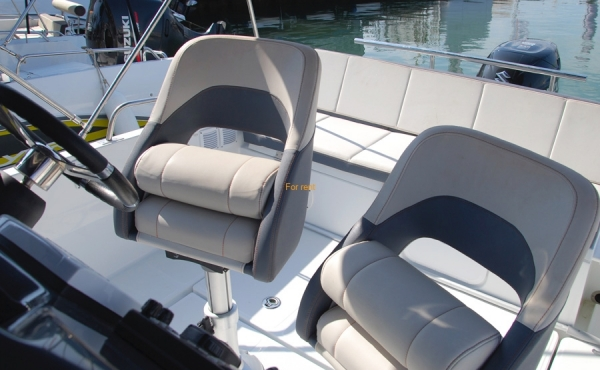 Two fold away grey chairs on board 5.5 Spacedeck