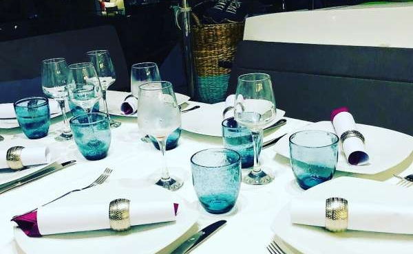 Table laid out with plates and glasses