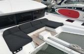 Black sunbathing cushions on board