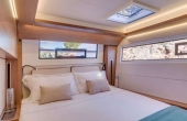 Master cabin with a fresh linen and large windows