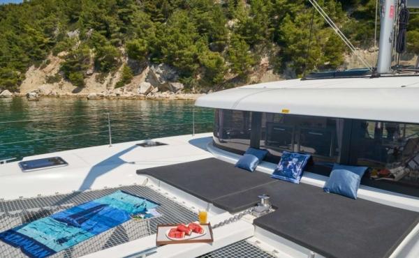 Grey sunbathing cushions on board Aura