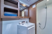 Large electric shower room with ample storage