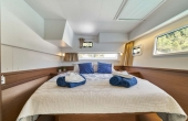 Master guest cabin with long large windows and double bed