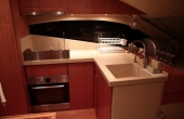 L shaped kitchen area with modern appliances