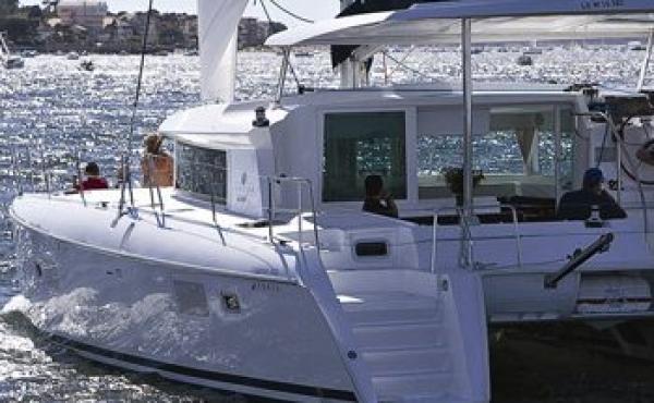 Family on holiday on a lagoon Catamaran
