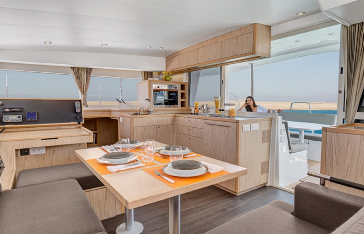 Lagoon 400 beige and orange interior inside the galley
