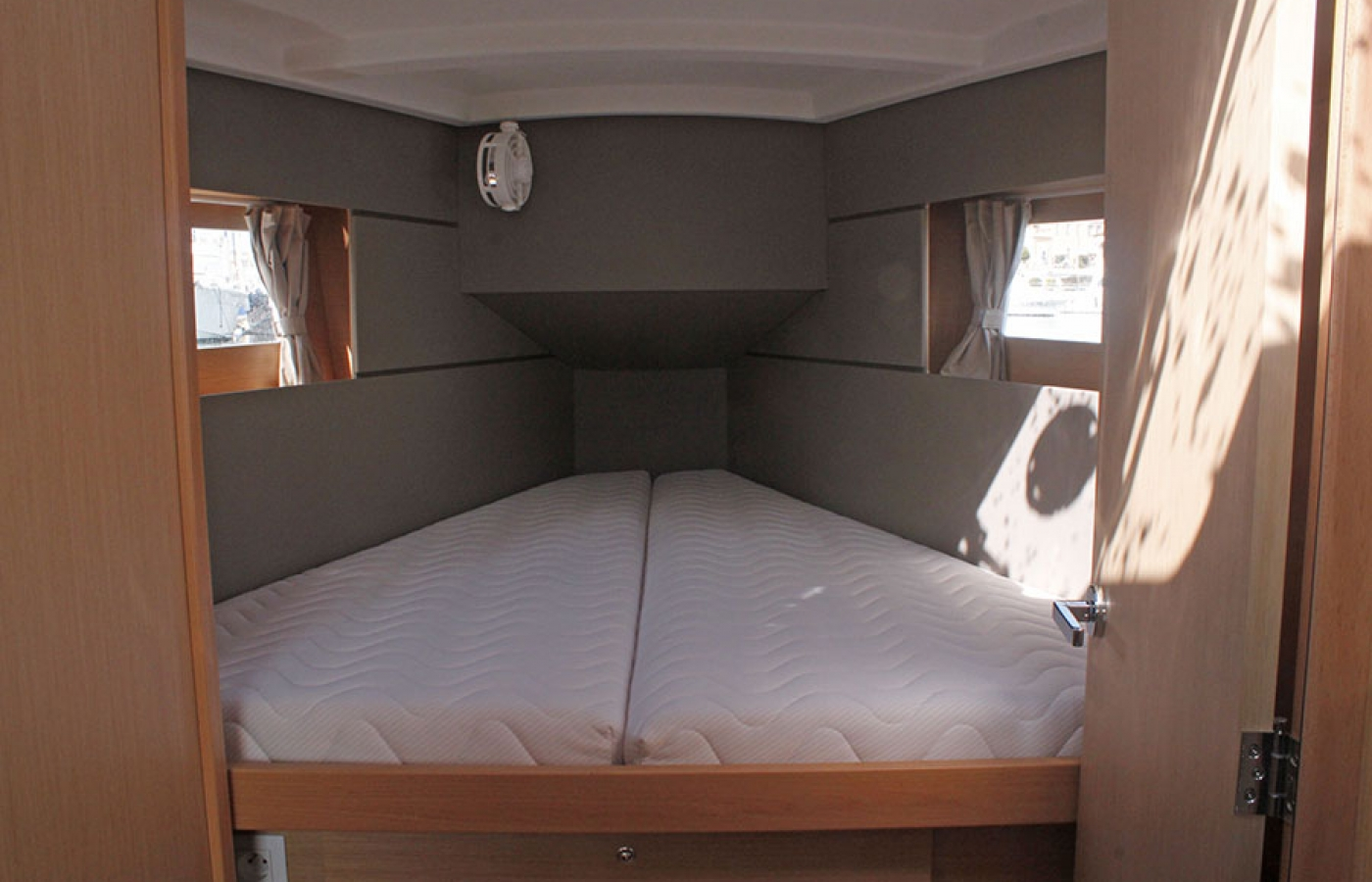 Large cabin with bed, storage and two windows