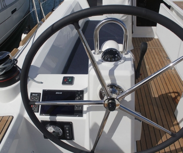 Skipper area with steering wheel and modern navigation equipment