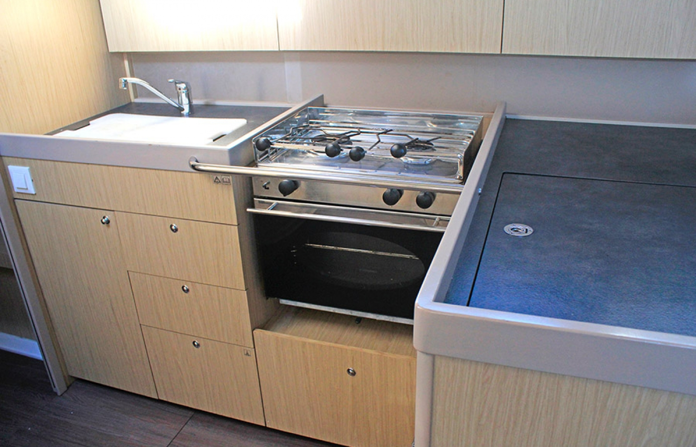 Silver modern kitchen appliances to make cooking on board easy