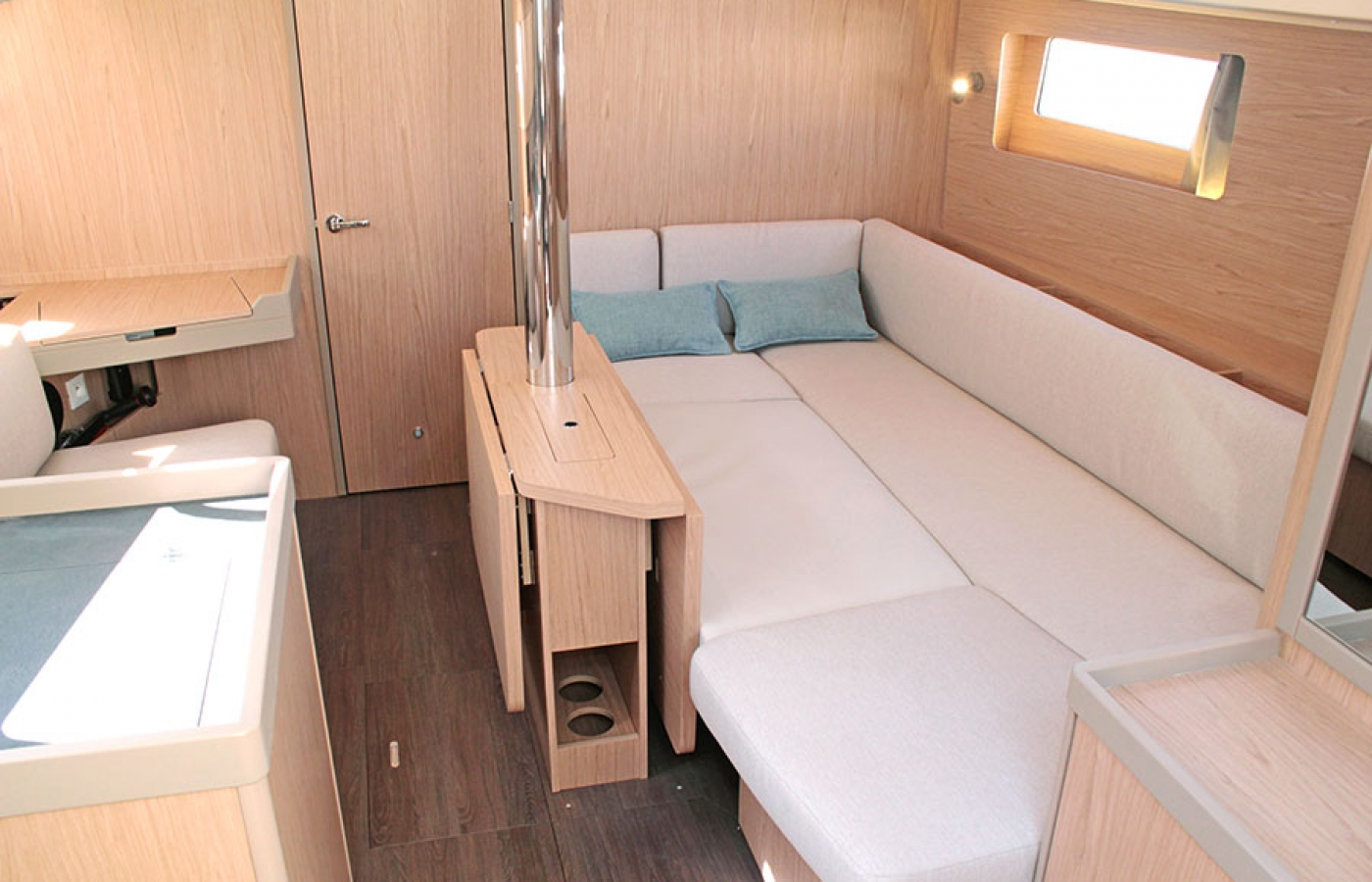 L shaped seating area in the galley transformed in to a eatra bed