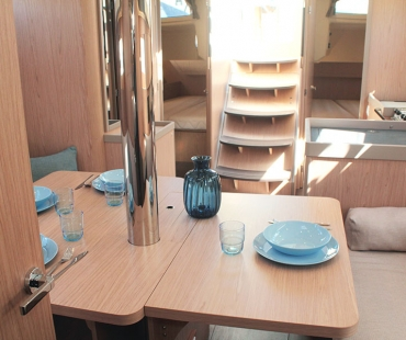 Bright dining area with straicase leading to the top deck