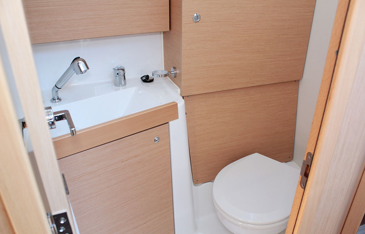 Head, sink and storage area on board
