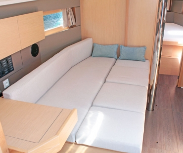 L shaped seating transformed into an extra bed onboard