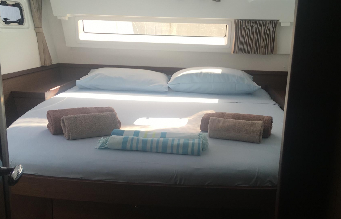 Spacious master cabin with luxury bed linen and towels.