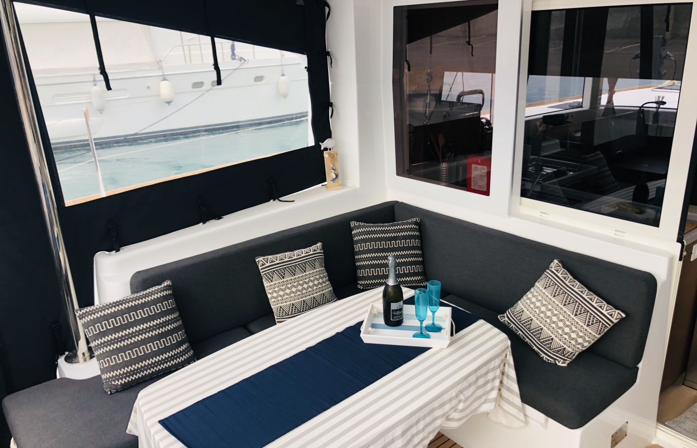 Navy and white interior on board the outdoor seating area
