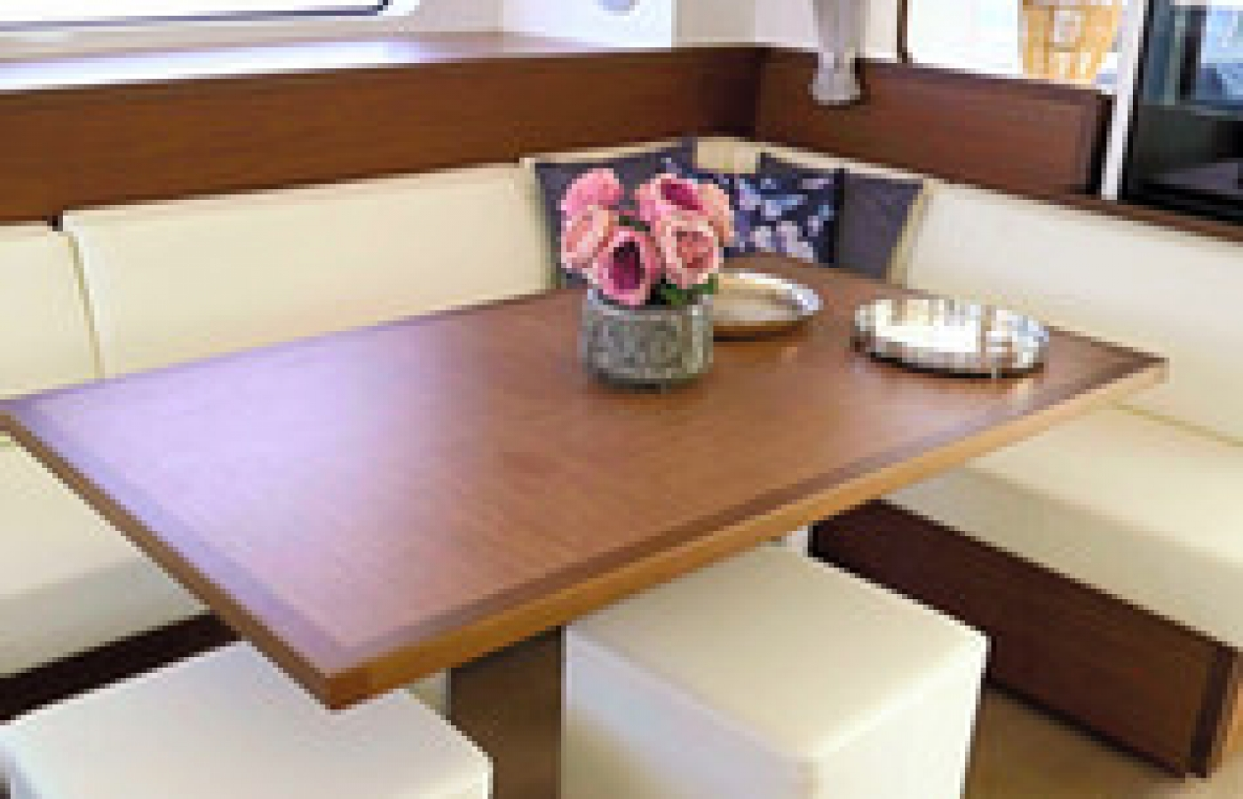 Cream and soft wood colours for the seating in the dining area