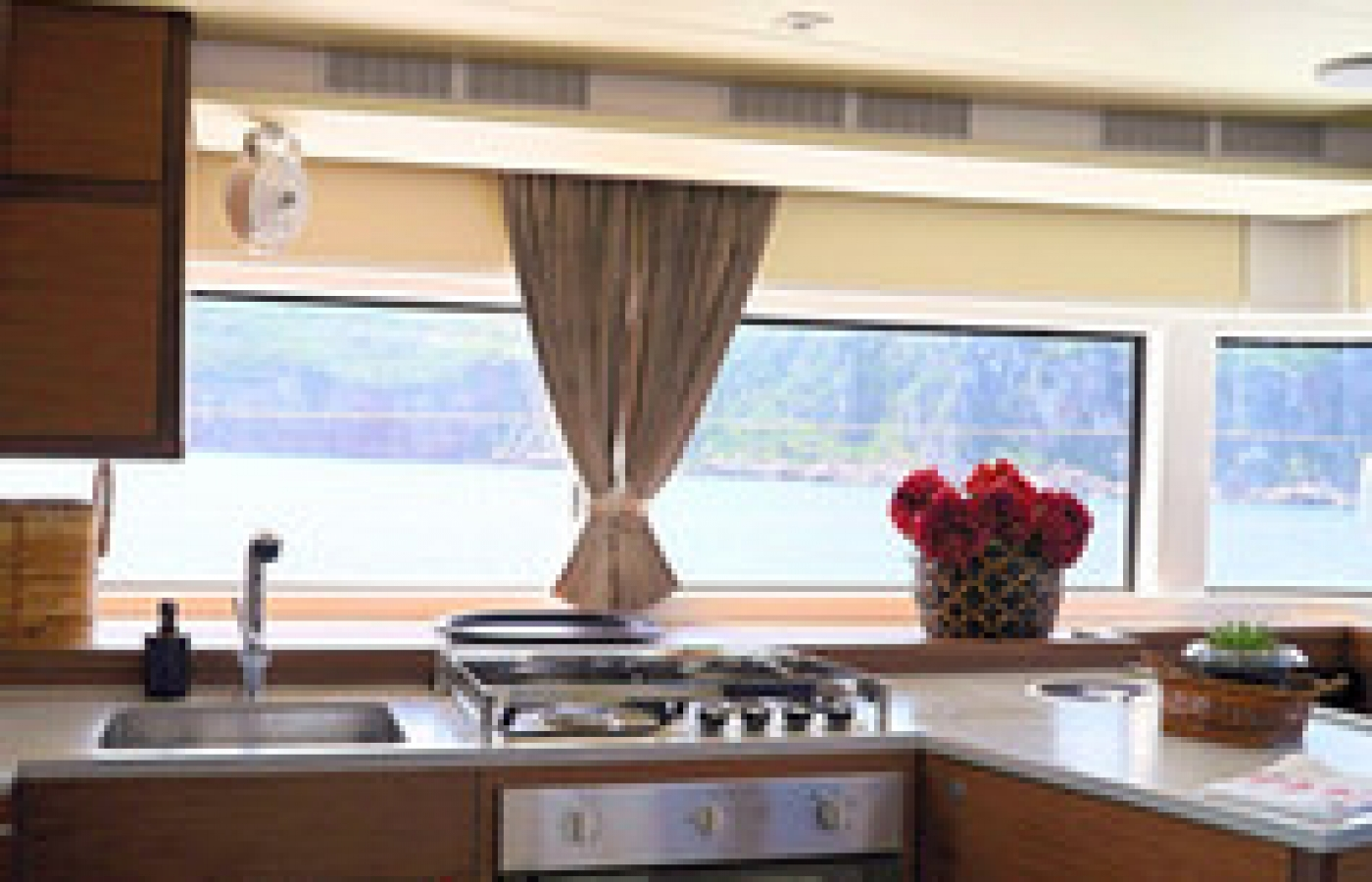 Open plan kitchen with large windows to see the magnificent views
