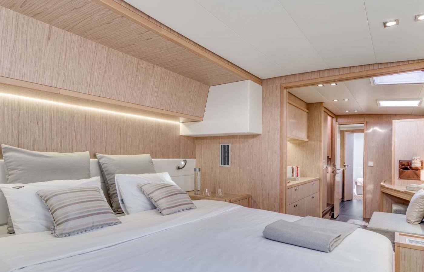 Double bedroom with bright lighting and storage space