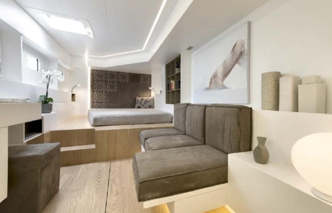 L shaped dark grey leather seating inside cabin