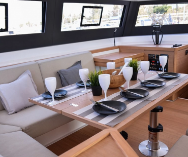 Seating around the dining table with black and white cutlery