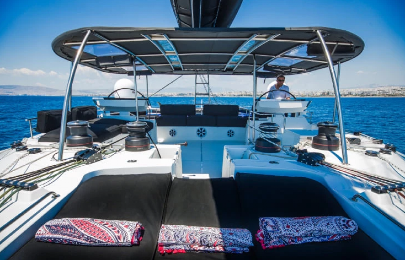 Black sunbathing cushions on board the Lagoon 620