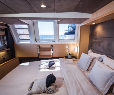 Luxury master cabin with large windows and double bed