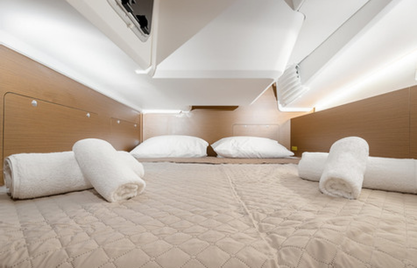 Cream and white bed sheets in the cabin