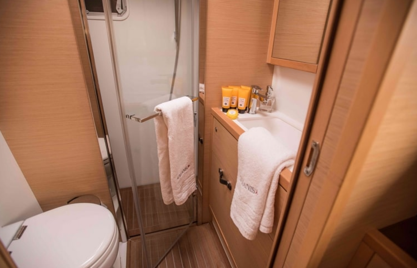 Bright en-suit bathroom with electric toilet and shower