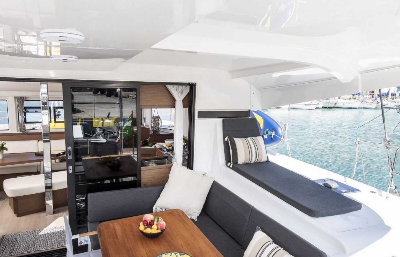 Large sliding doors with white and navy seating at the stern