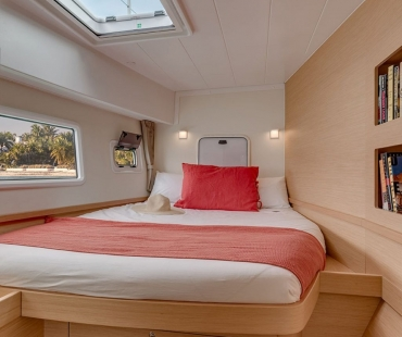 Single bed inside third cabin with large window