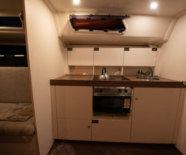 The galley with modern cooker, oven and microwave