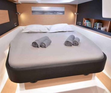 Spacious cabin with clean grey towels