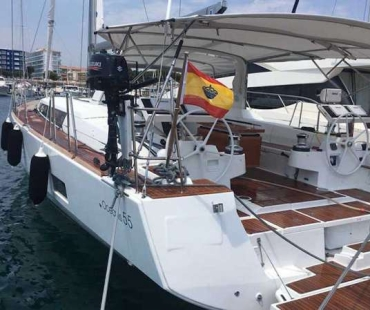 The steering wheel and Spanish flag at the stern of the boat